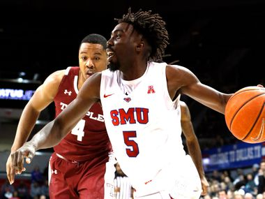 FILE - SMU guard Emmanuel Bandoumel (5) drives the baseline past Temple forward J.P. Moorman ll (4) during the first half of a game at Moody Coliseum on the campus of SMU in Dallas on Jan. 18, 2020.