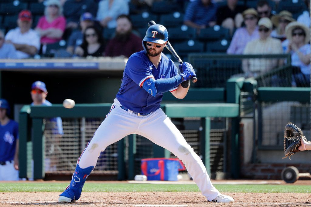 Texas Rangers' Joey Gallo eyes a ball at bat during a spring training baseball game Thursday, March 5, 2020, in Surprise, Ariz. (AP Photo/Elaine Thompson)