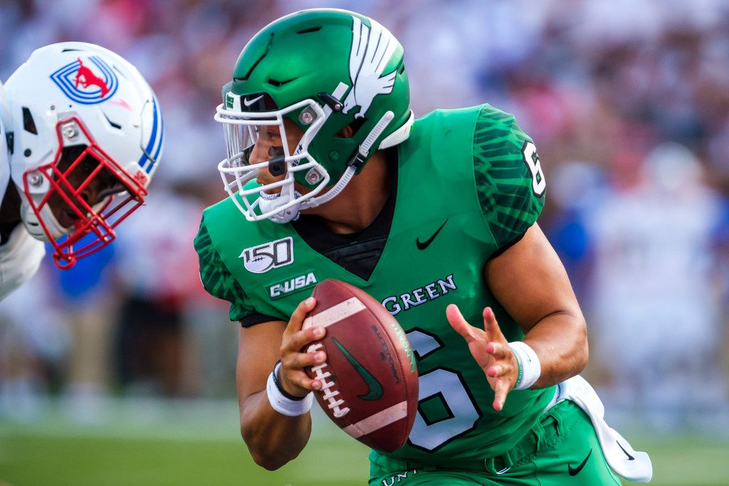 UNT quarterback Mason Fine (6) scrambles away from the SMU pass rush during the first half of an NCAA football game at Ford Stadium on Saturday, Sept. 7, 2019, in Dallas. (Smiley N. Pool/The Dallas Morning News)