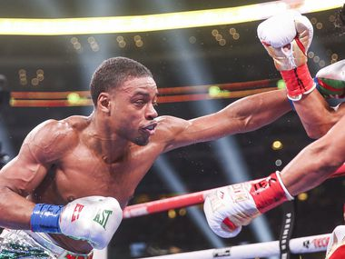 Errol Spence Jr. lands a punch on Mikey Garcia during a IBF World Welterweight Championship match on March 16, 2019 at AT&T Stadium in Arlington, Texas.