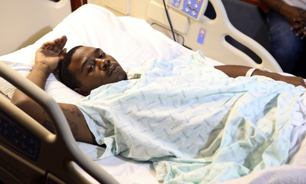 Kelvion Walker, 19, talks to the media at Baylor University Medical Center in Dallas in 2013. Walker was shot in the chest by Senior Cpl. Amy Wilburn.