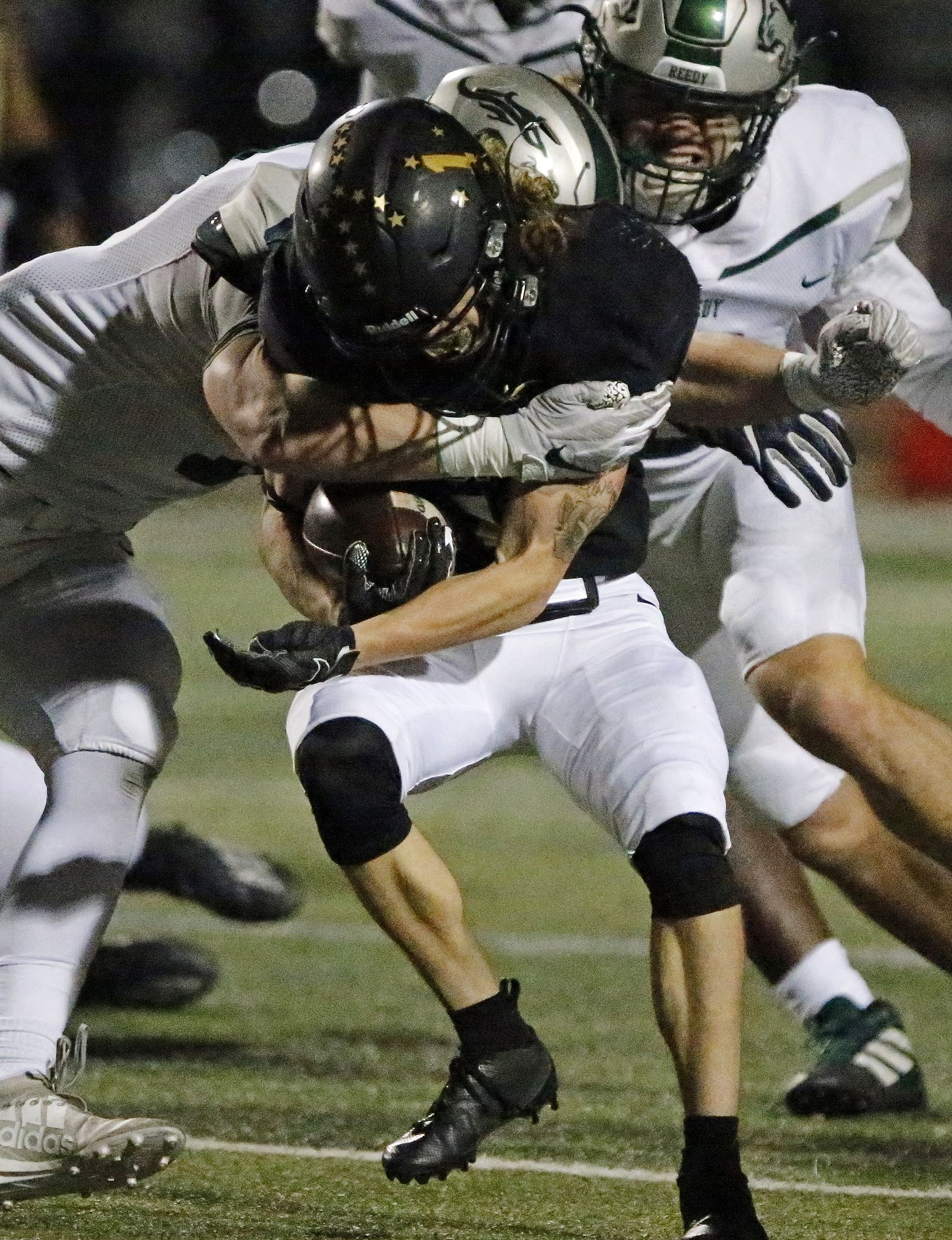 The Colony High School wide receiver Benji Nelson (1) is hit by Reedy High School defensive back Camden Hardy (9) and Nelson was able to shake the tackle during the first half as The Colony High School hosted Frisco Reedy High School at Tommy Briggs Stadium on Friday night, December 4, 2020.  (Stewart F. House/Special Contributor)