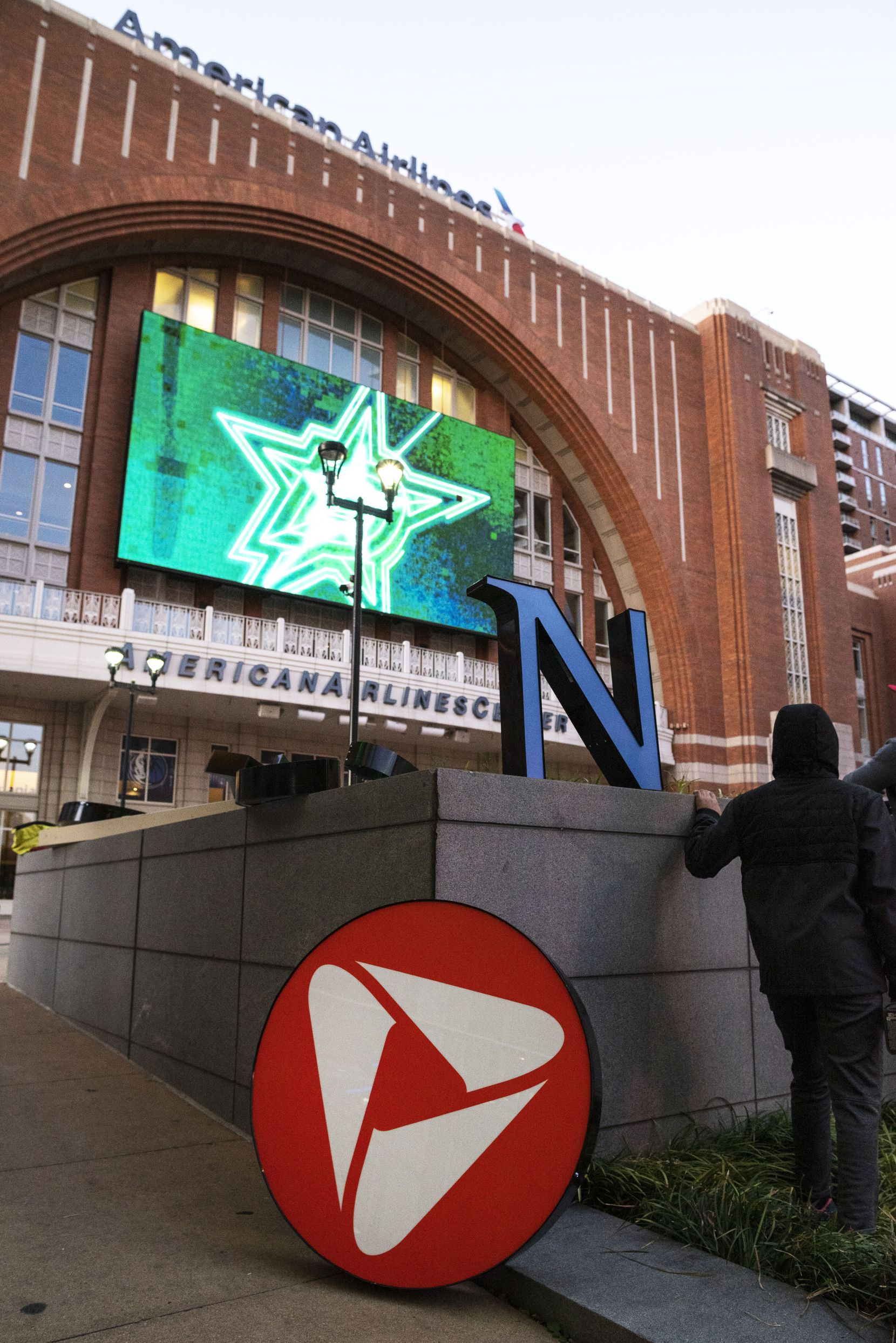 A crew spent Monday preparing to install the PNC Bank logo at Victory Plaza outside the American Airlines Center in Dallas.