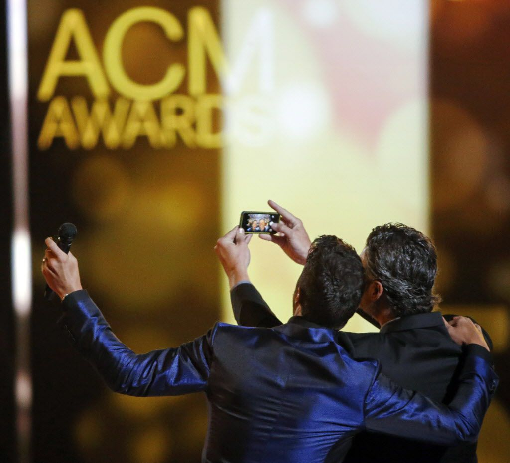 Hosts Luke Bryan (left) and Blake Shelton take a selfie on stage during the 2015 Academy of County Music Awards Sunday, April 19, 2015 at AT&T Stadium in Arlington, Texas.