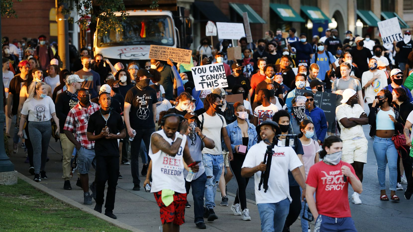 Protestors march through Dealey Plaza before heading in another direction to reach northbound Interstate 35. Police fired projectiles at them forcing them off the Interstate. They gathered to protest the in-custody death of George Floyd in downtown Dallas, Saturday, May 30 2020. (Tom Fox/The Dallas Morning News)