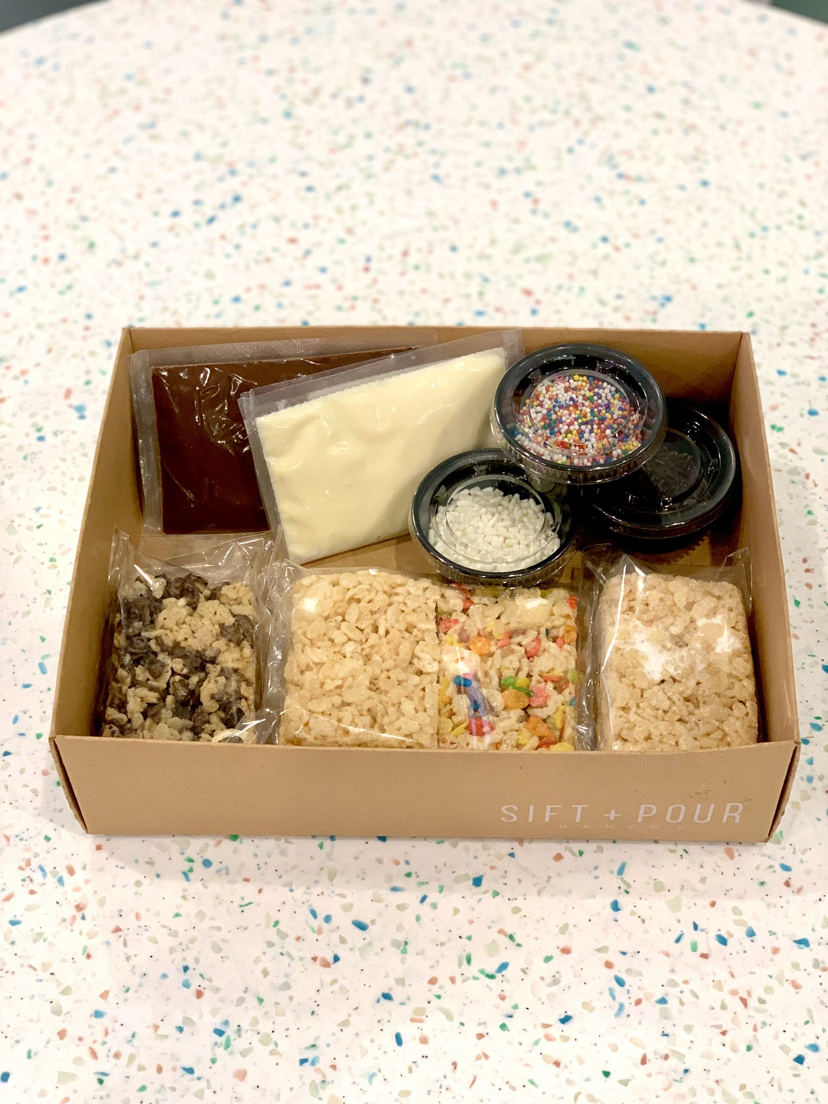 Sift + Pour's survival kit is gluten-free-friendly with four Rice Krispies Treats, chocolate and white chocolate frosting, and sprinkles for $25.