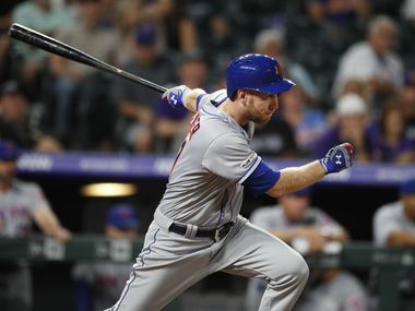 FILE - New York Mets' Todd Frazier watches his RBI single off Colorado Rockies pitcher Rico Garcia during the ninth inning of a baseball game Tuesday, Sept. 17, 2019, in Denver. The Mets won 6-1. (AP Photo/David Zalubowski)