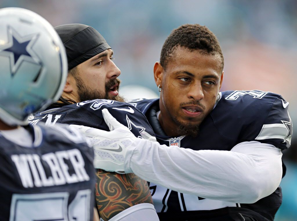 Dallas Cowboys defensive end Greg Hardy (right) hugs defensive tackle Nick Hayden before their game against the Miami Dolphins Sun Life Stadium Sunday, November 22, 2015 in Miami Gardens, Fla. (G.J. McCarthy/The Dallas Morning News)