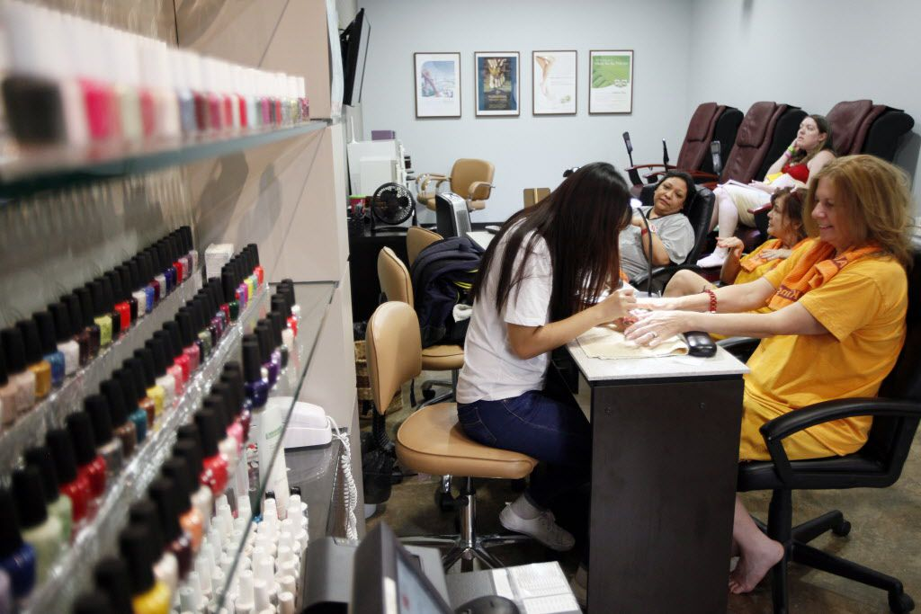 "Janet Paulson, right, of Houston, has her nails worked on inside King Spa, on Wednesday, Oct. 06, 2015 in Dallas. Pualson was visiting King Spa while spending time with a friend. ""They don't have anything like this in Houston,"" said Paulson. Ben Torres/Special Contributor"