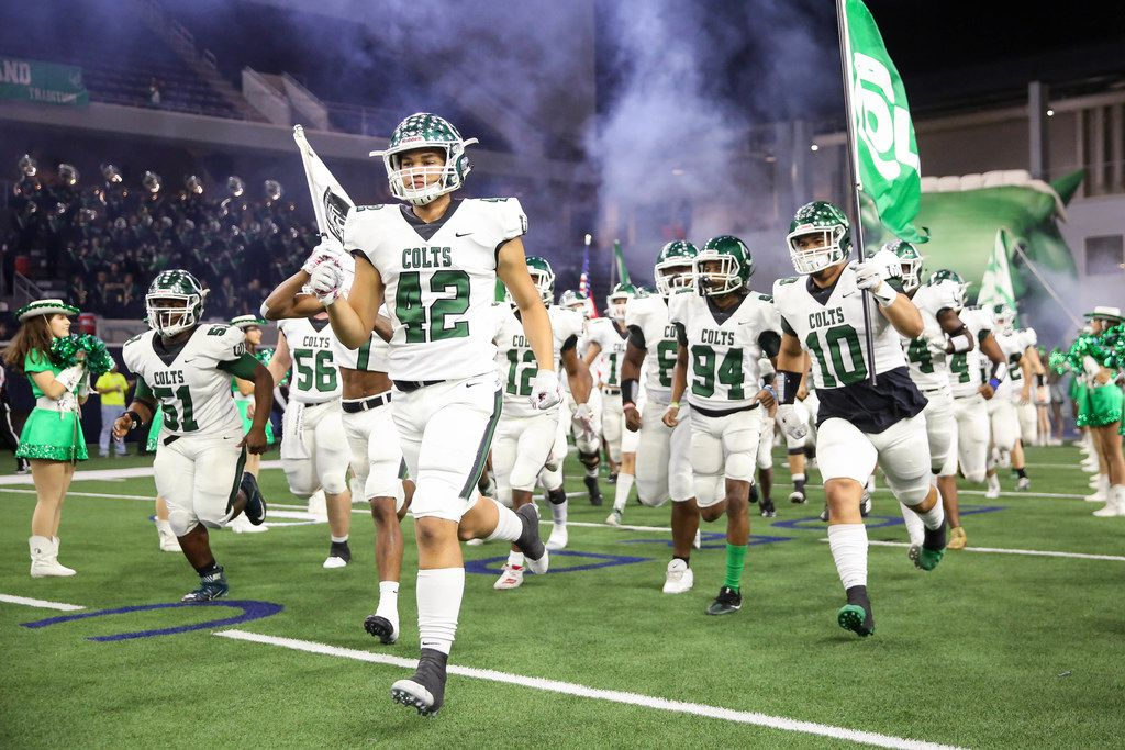 The Arlington Colts run out for the start of a Class 6A Division II Region I semifinal game against the Guyer Wildcats at the Star in Frisco, on Saturday, November 30, 2019. Guyers leads 21-0 at halftime . (Juan Figueroa/The Dallas Morning News)