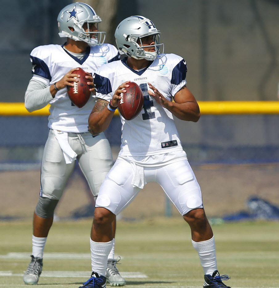 Dallas Cowboys quarterbacks Dak Prescott (4) and Jameill Showers (7) perform drop back drills during afternoon practice at training camp in Oxnard, California, Thursday, August 4, 2016. (Tom Fox/The Dallas Morning News)
