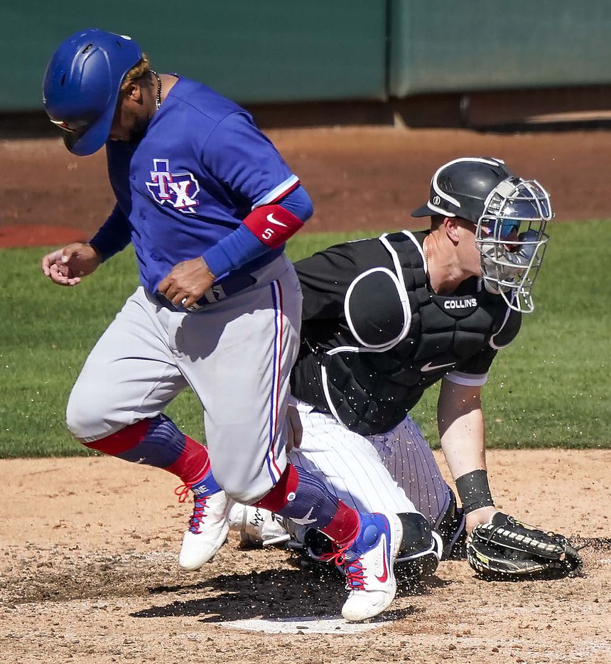 Texas Rangers outfielder Willie Calhoun scores past the tag of Chicago White Sox catcher Zack Collins on a sacrifice fly by Adolis García during the fifth inning of a spring training game at Camelback Ranch on Tuesday, March 2, 2021, in Phoenix, Ariz.