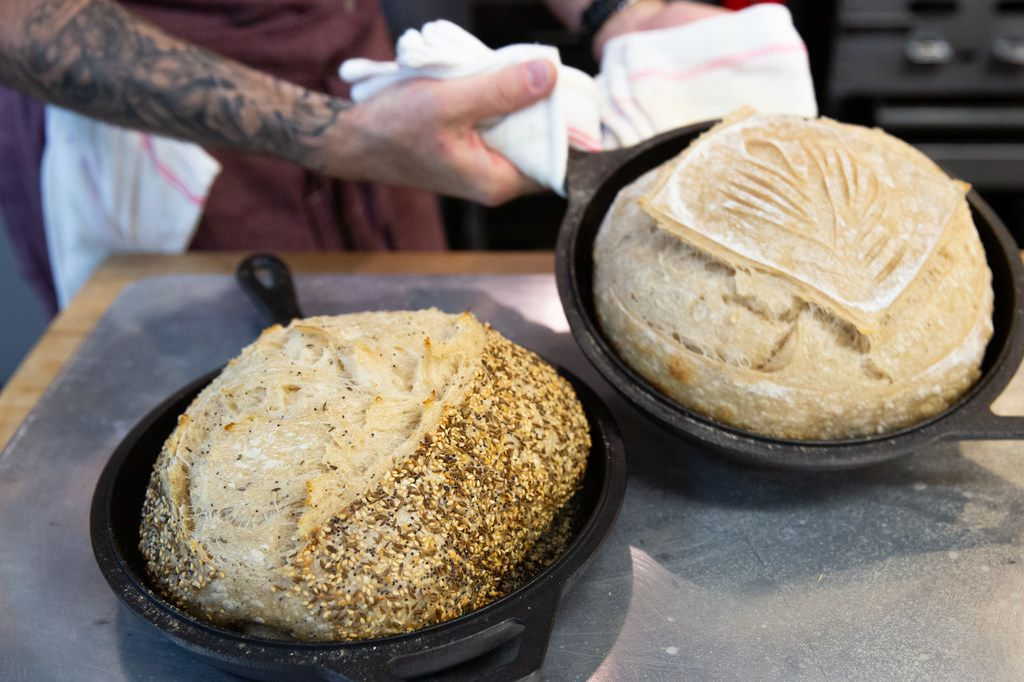 Matt Bresnan, head chef at Food Company, removes two loaves of bread in the Nonna kitchen.
