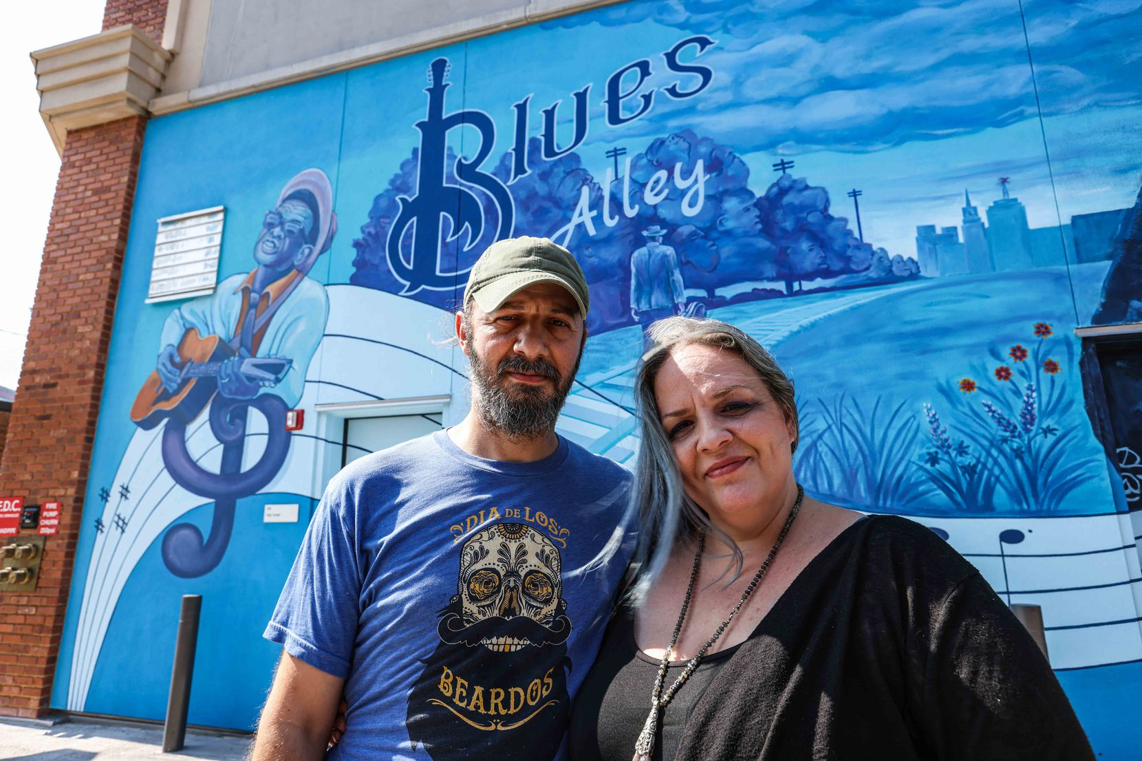 Dan and Cathryn Colcer, the project's curators, pose in the alley in July.