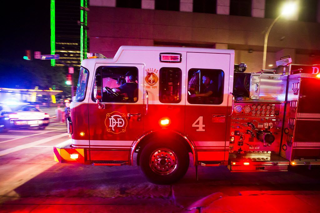 A Dallas Fire Rescue truck moves through an intersection into an area blocked off to the public as police go through downtown Dallas searching for suspects in the shooting of multiple police officers after shots were fired at a Black Live Matter rally on Thursday, July 7, 2016. Smiley N. Pool/Staff Photographer