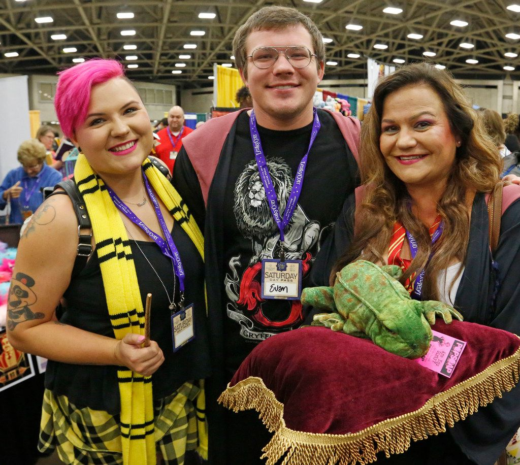 Kelsey, Evan and Sherri Gool, left to right,  of Round Rock pose for a photo at LeakyCon.