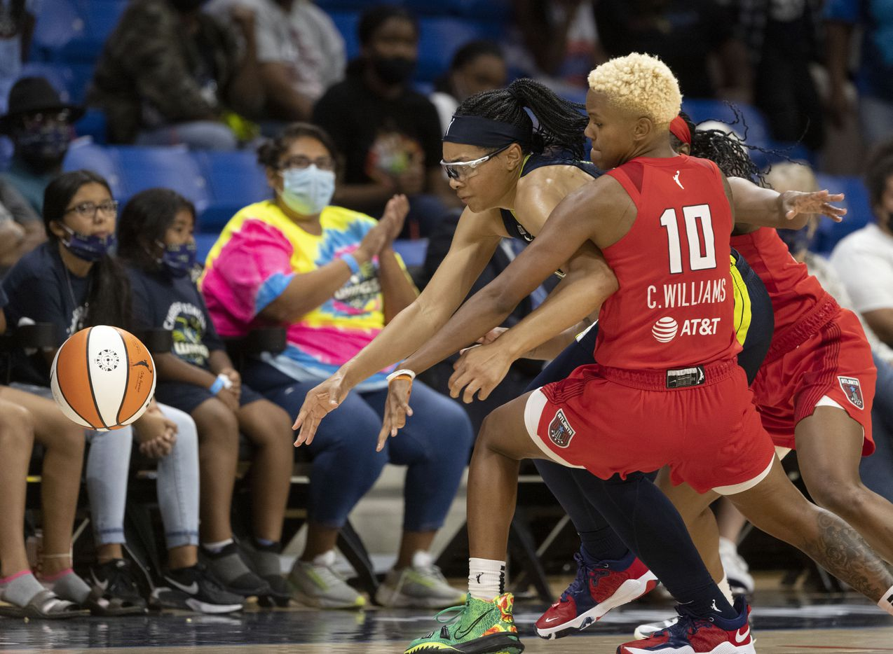 Dallas Wings guard Allisha Gray (15) and Atlanta Dream guard Courtney Williams (10) go for the ball during the second half of their WNBA basketball game in Arlington, Texas on Sept. 2, 2021. Dallas won 72-68. (Michael Ainsworth/Special Contributor)