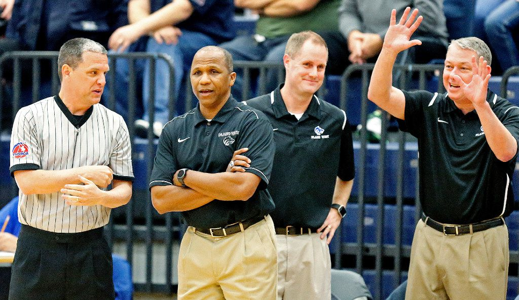 Plano West head coach Anthony Morgan (left center) tries to get an explanation for a call from a ref during the first half as Allen High School hosted Plano West High School at Allen High School on Friday, January 20, 2016. (Stewart F. House/Special Contributor)