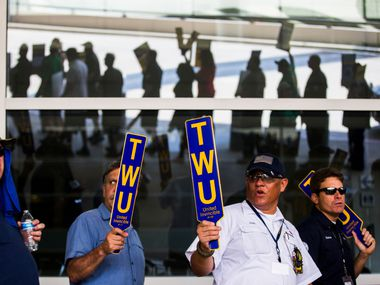 American Airlines employees protest the lack of a new contract for baggage carriers, mechanics and other staff.