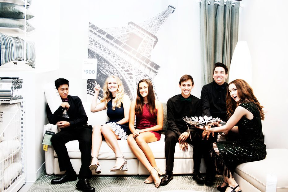 A cocktail party in someone's living room? Hardly: It's a photo shoot at Ikea in Frisco before these teenagers went to Frisco Heritage High School's homecoming dance.