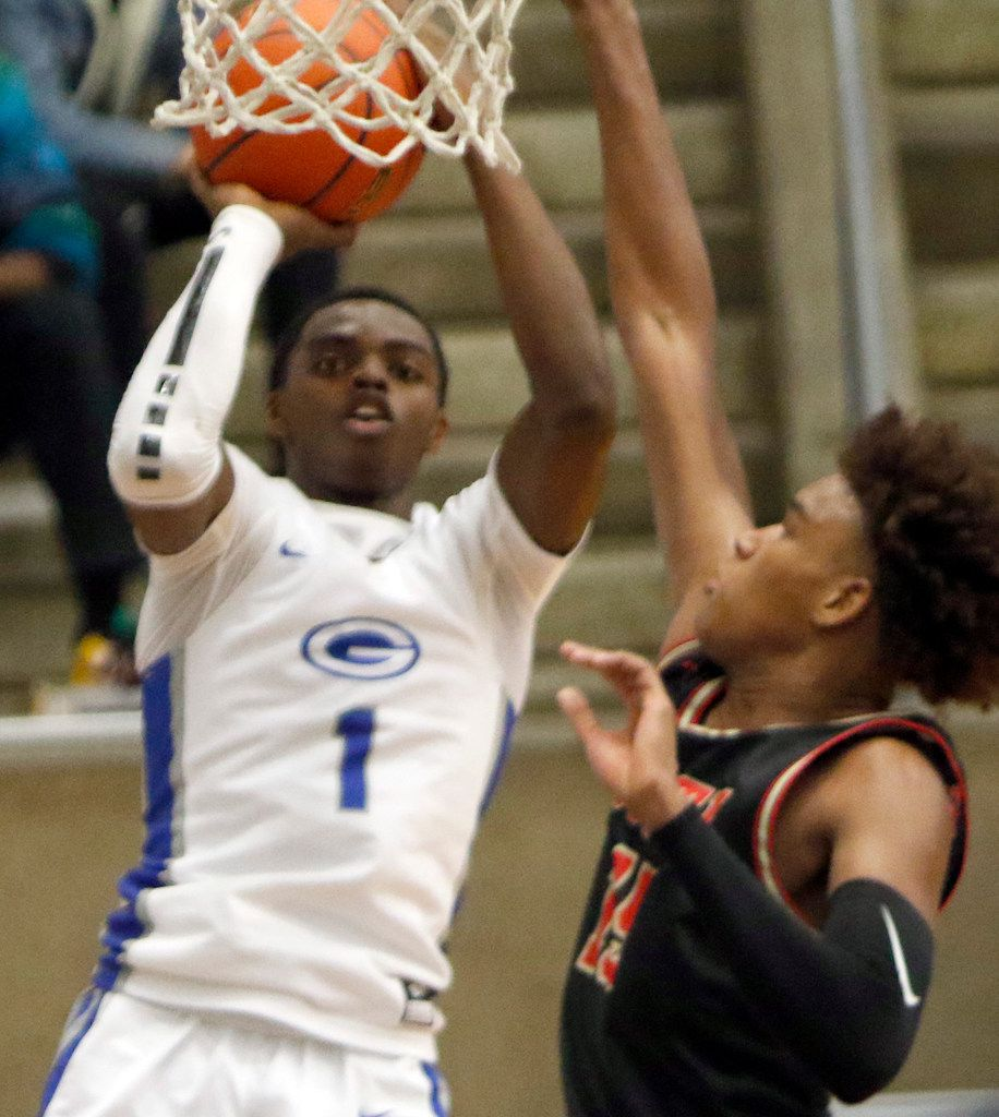 Grand Prairie's Jaylin Posey (1) shoots over the defense of South Grand Prairie's Christian Turner (15) during second half action. Grand Prairie won, 72-68. The two teams played their boys basketball game at  Grand Prairie High School in Grand Prairie on January 11, 2020. (Steve Hamm/ Special Contributor)