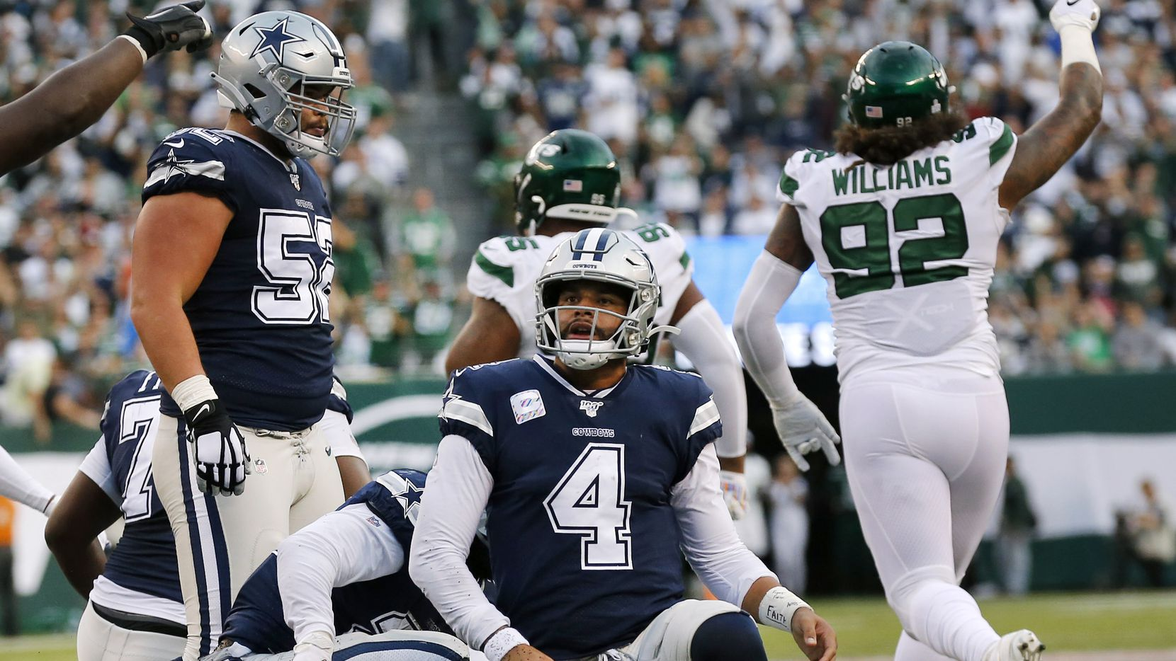 Dallas Cowboys quarterback Dak Prescott (4) gets back to his feet after being stopped short on 4th down against the New York Jets in the second quarter during at MetLife Stadium in East Rutherford, New Jersey, Sunday, October 13, 2019.
