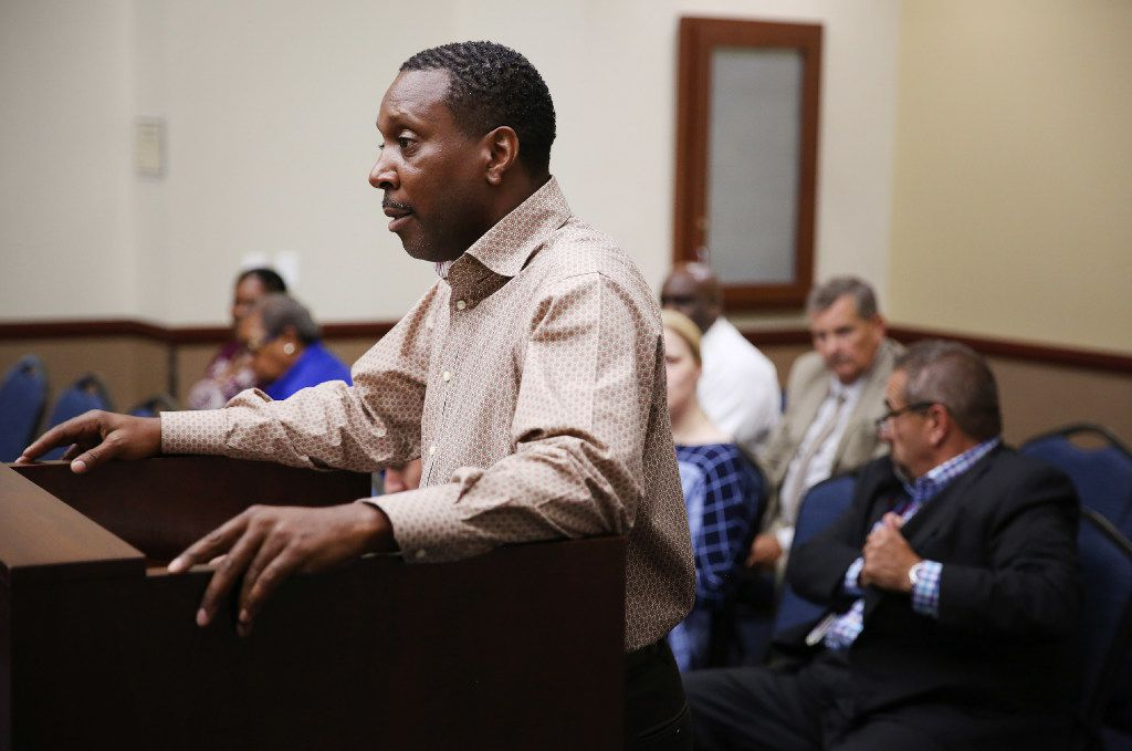 Former Dallas County Schools driver Albert Walker, who is now a teacher, looked at trustee Larry Duncan when calling for Duncan to step down during a Dallas County Schools board of trustees meeting at their headquarters in Dallas.