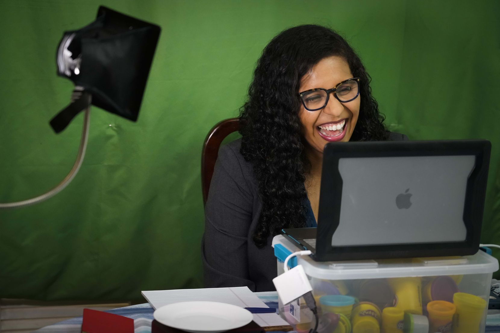 Candace Valenzuela, candidate for TexasÕ 24th Congressional District, holds a virtual fundraiser from her dining room table on Wednesday, June 24, 2020, in Dallas. Valenzuela faces Kim Olson in the Democratic primary runoff on July 14th. (Smiley N. Pool/The Dallas Morning News)