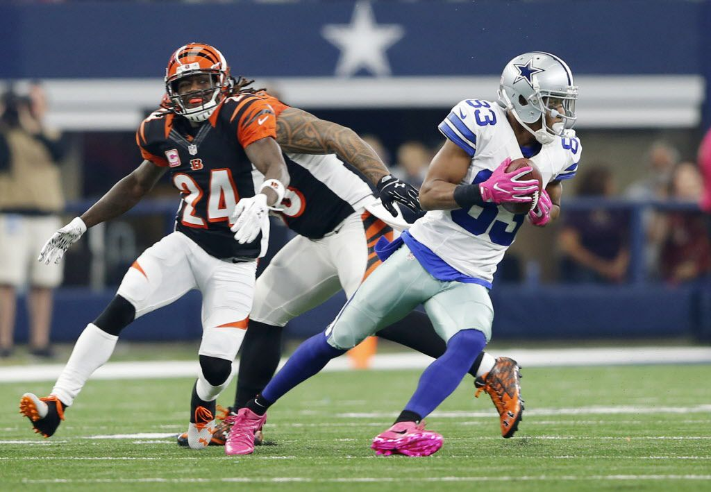 Dallas Cowboys wide receiver Terrance Williams (83) catches a pass for a first down as he is defended by Cincinnati Bengals cornerback Adam Jones (24) during the first half of play at AT&T Stadium in Arlington on Sunday, October 9, 2016. (Vernon Bryant/The Dallas Morning News)