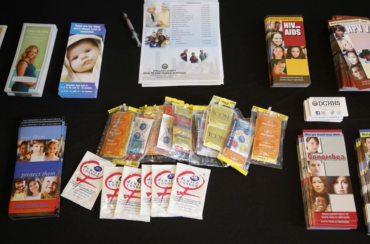 Contraceptives and information about pregnancy and sexually transmitted diseases are displayed on a table during a National Day to Prevent Teen Pregnancy Fair in Dallas.