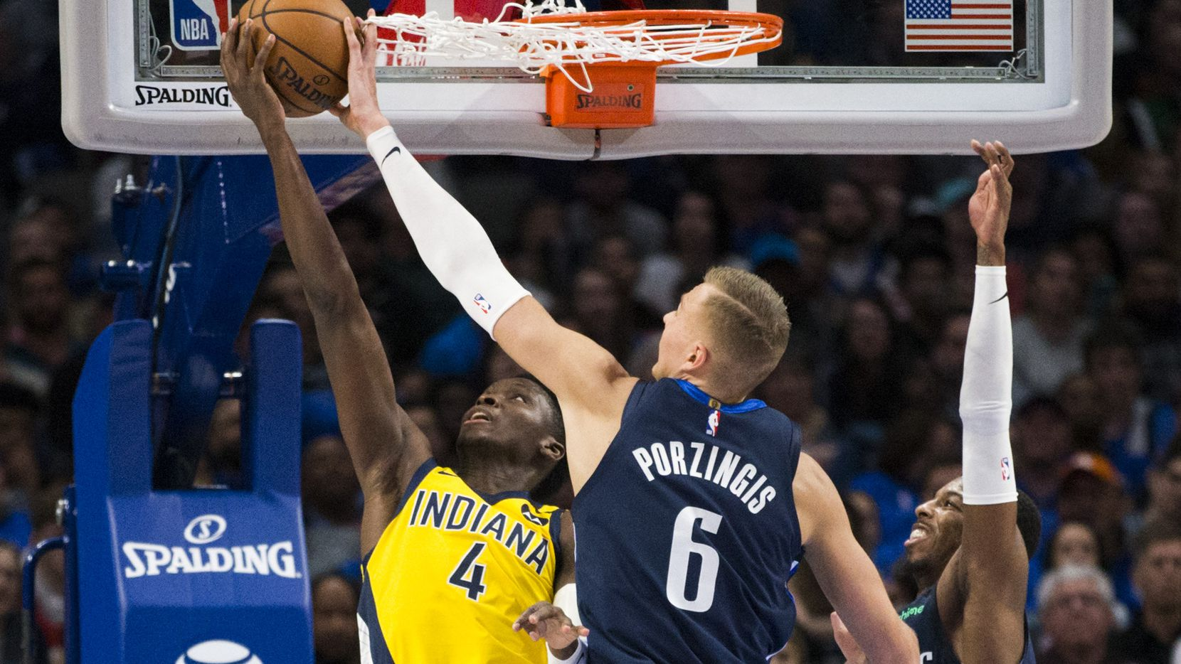 Dallas Mavericks forward Kristaps Porzingis (6) blocks a shot by Indiana Pacers guard Victor Oladipo (4) during the fourth quarter of an NBA game between the Indiana Pacers and the Dallas Mavericks on Sunday, March 8, 2020 at American Airlines Center in Dallas.