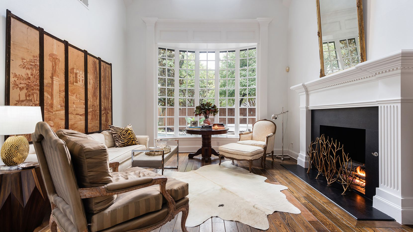 The residence at 6444 Mimosa Lane in Preston Hollow has four living areas and a remodeled kitchen.