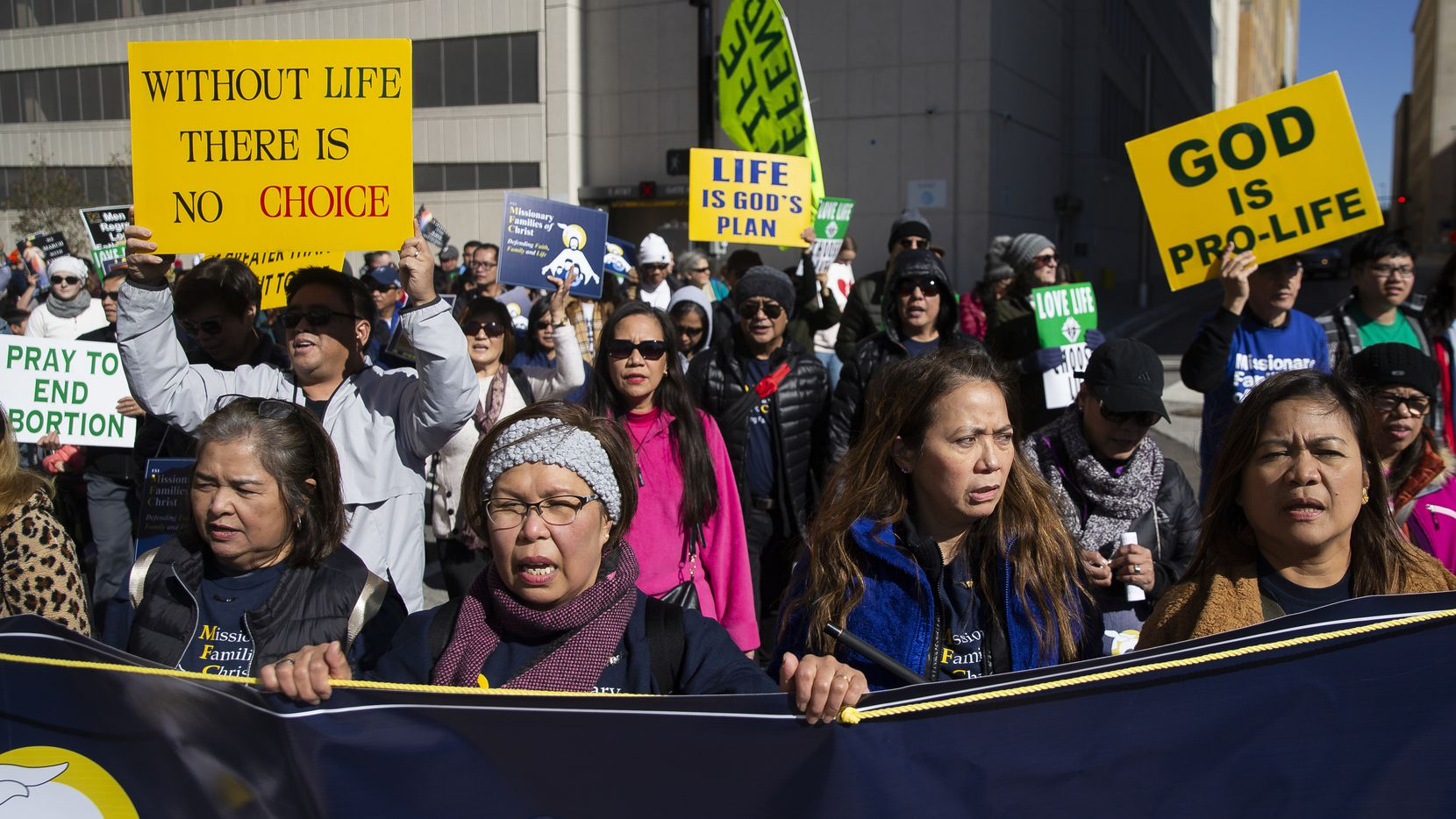 Demonstrators march from the Cathedral Santuario de la Virgen de Guadalupe to the Earle Cabell Federal Courthouse during the North Texas March for Life on Saturday, Jan. 18, 2020, in downtown Dallas. The Roe vs. Wade lawsuit was originally filed in Dallas.