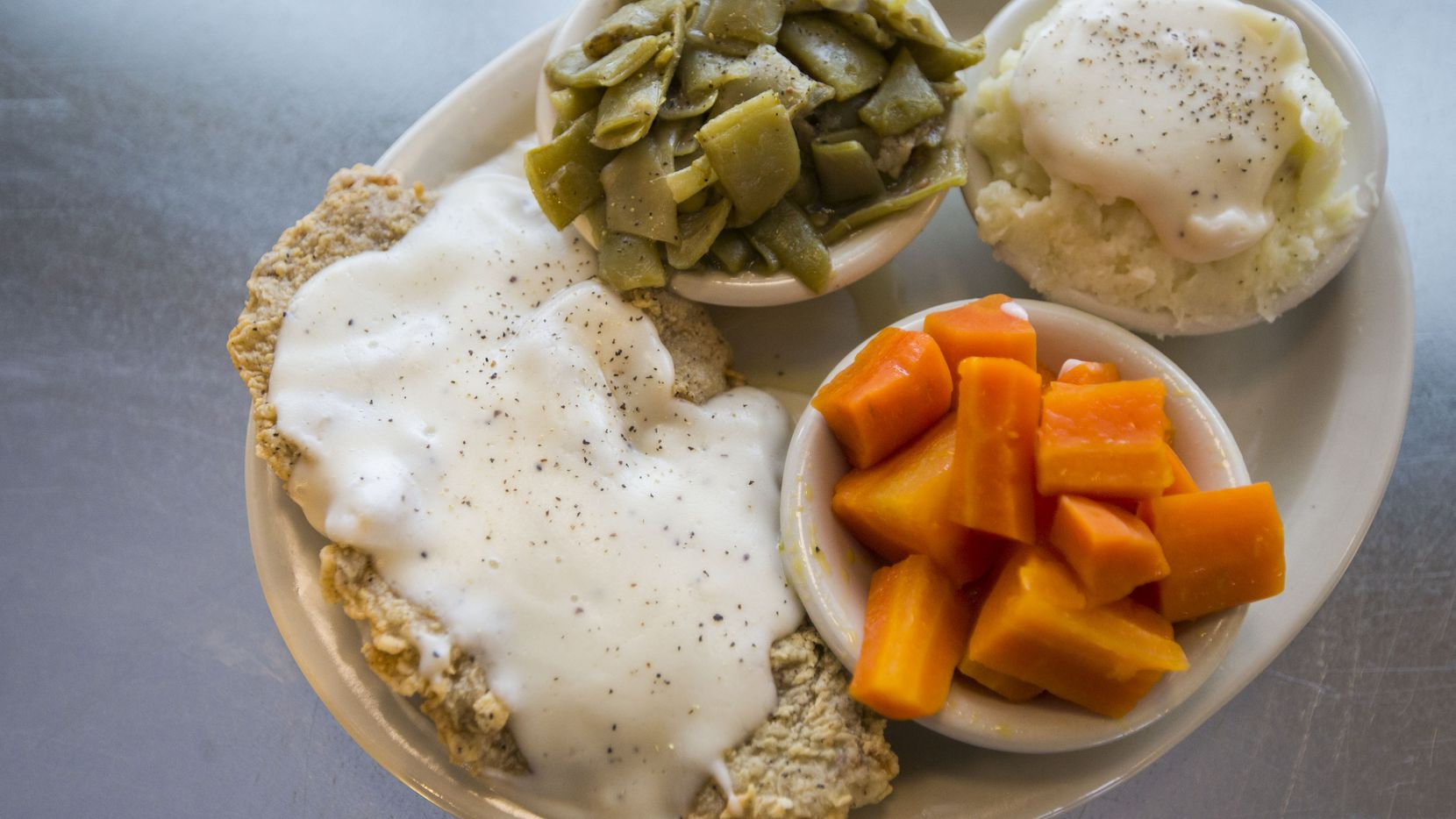 A plate of chicken fried steak, carrots, green beens, and mashed potatoes will be available for $1.79 at Norma's Cafe on June 23.