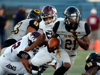 Garland RB Jayshon Powers (21) picks up yards through the Wylie high defense during the first half a high school football game at Williams Stadium in Garland on Thursday, September 17, 2021. (John F. Rhodes / Special Contributor)