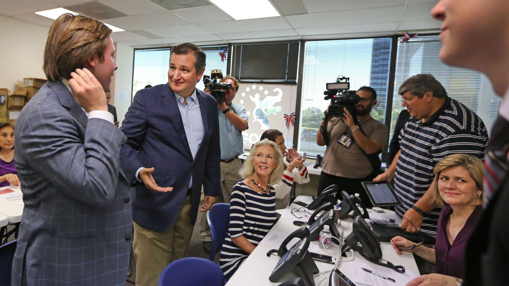 Sen. Ted Cruz stopped at Republican Party headquarters in Dallas on Thursday to encourage volunteers there working on getting the vote out.