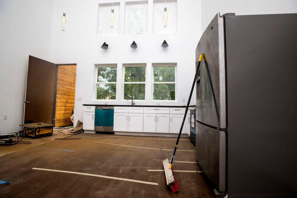 The kitchen area in the home of architect Jay Taylor, who built this house in Oak Cliff in Dallas. Taylor is designing infill projects for empty lots in the neighborhood. (Carly Geraci/The Dallas Morning News)