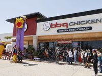 Confetti flies through the air during a grand opening event at BBQ Chicken on Sunday, April 11, 2021 in Richardson, Texas.