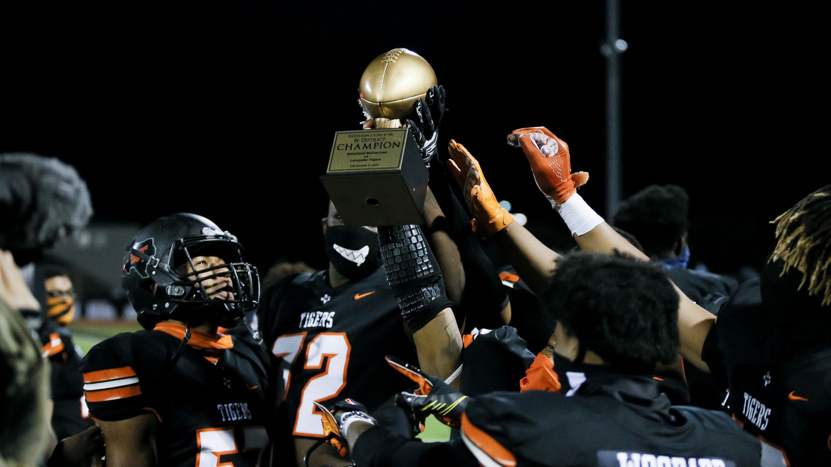 Lancaster celebrates a 29-6 win over Wakeland in a class 5A Division I bi-district round playoff game at Tiger Stadium in Lancaster, Friday, December 11, 2020. (Brandon Wade/Special Contributor)