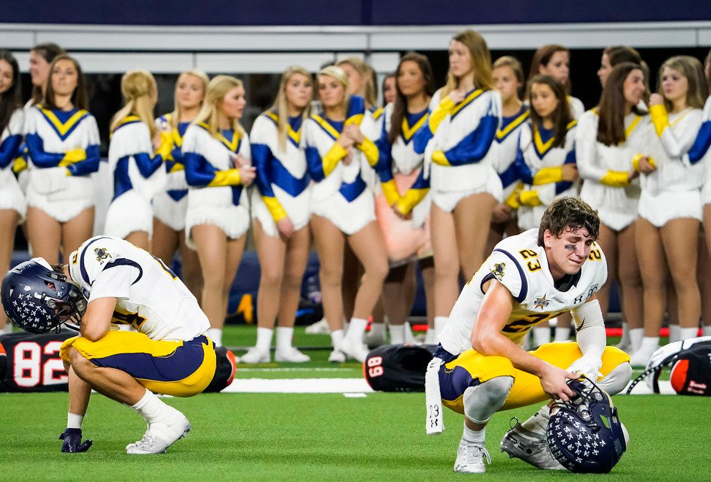 Highland Park defensive backs Andrew Bonnet (23) and John Beecherl (24) react after a 33-27 overtime loss to Frisco Lone Star in a Class 5A Division I Region II semifinal playoff football game at AT&T Stadium non Friday, Nov. 29, 2019, in Arlington. (Smiley N. Pool/The Dallas Morning News)