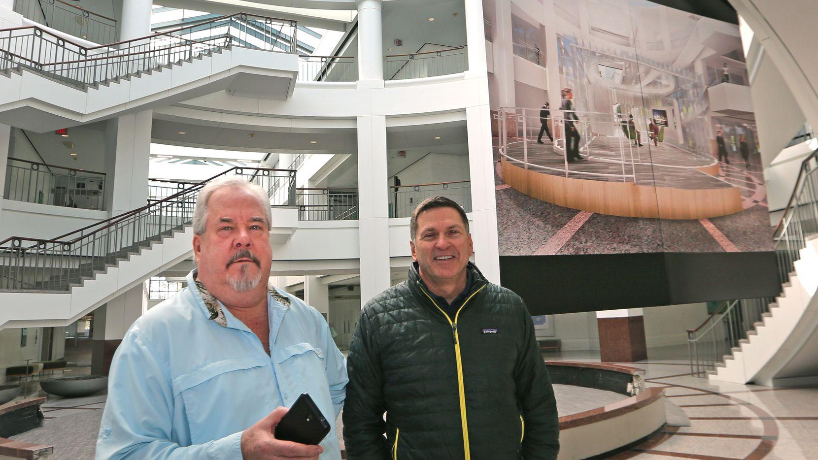 Developer Sam Ware (left) and COO Jeff Blakeley survey the newly-renovated space at the Campus at Legacy West in Plano.