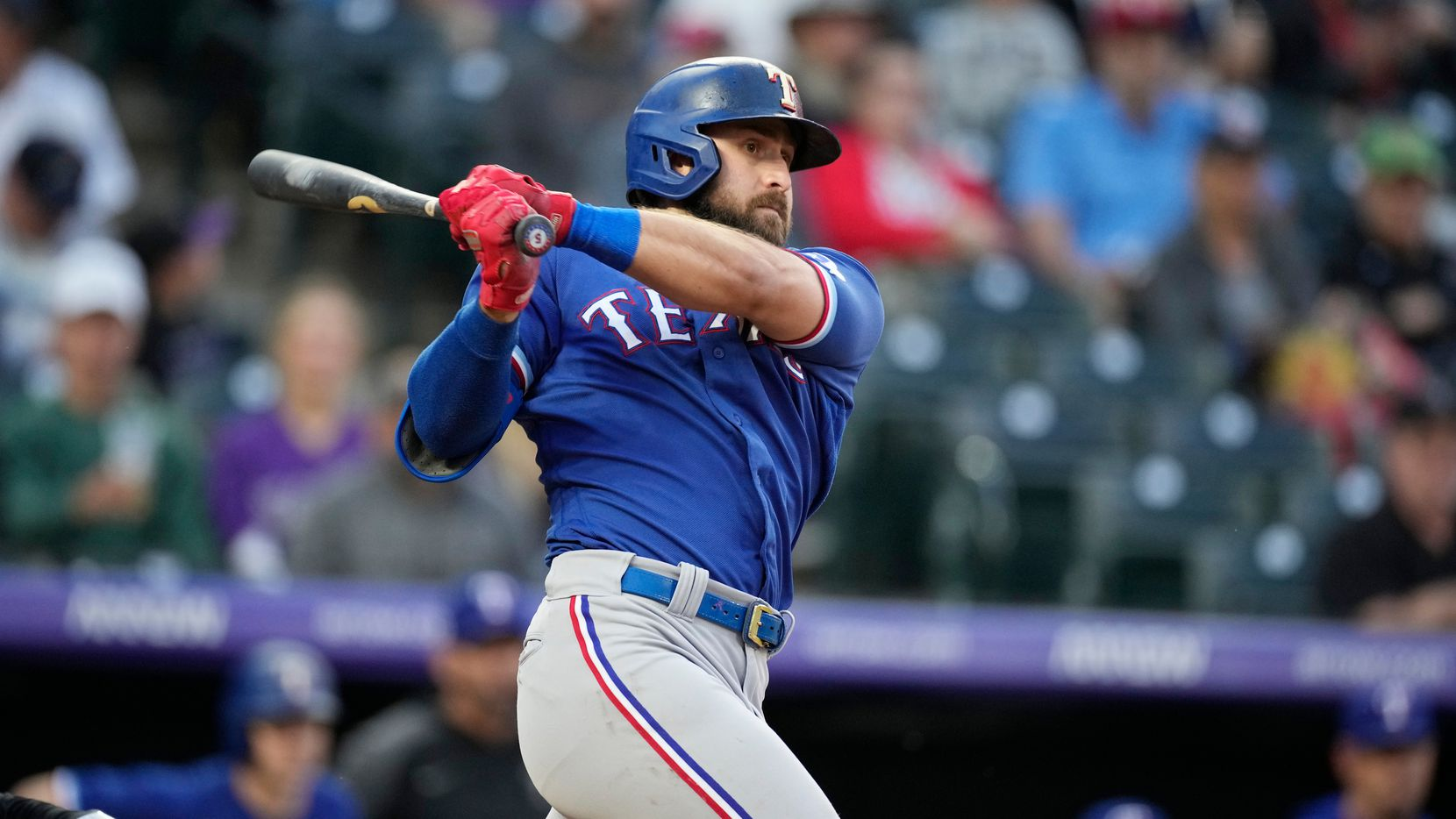 Texas Rangers' Joey Gallo grounds into a fielder's choice in the fourth inning of a baseball game against the Colorado Rockies Tuesday, June 1, 2021, in Denver. A run scored on the play.