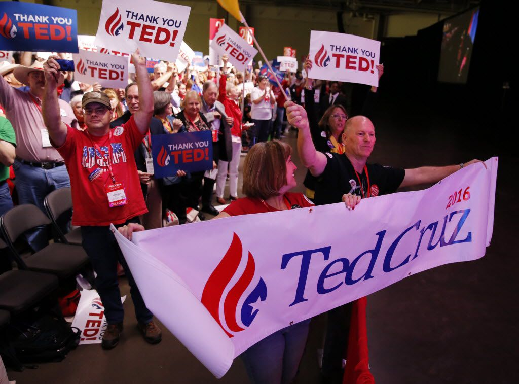 Collin County delegates Melissa and Richard Spence show their support for Sen. Ted Cruz as he speaks during the May, 2016 Texas Republican Convention at the Kay Bailey Hutchison Convention Center in Dallas. (Vernon Bryant/Staff Photographer)