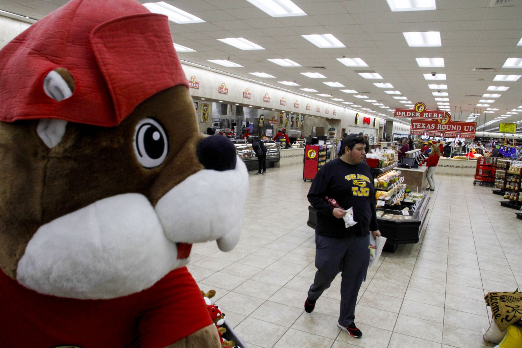 Jose Gonzalez walks by a large stuffed beaver at Buc-ee's in Terrell.