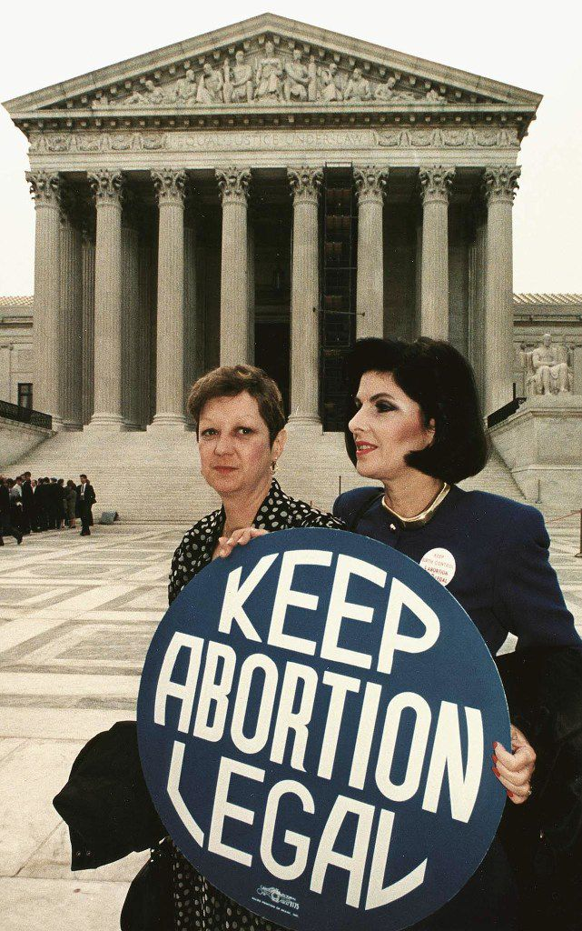 Norma McCorvey (left) with attorney Gloria Allred in front of the U.S. Supreme Court in 1989.