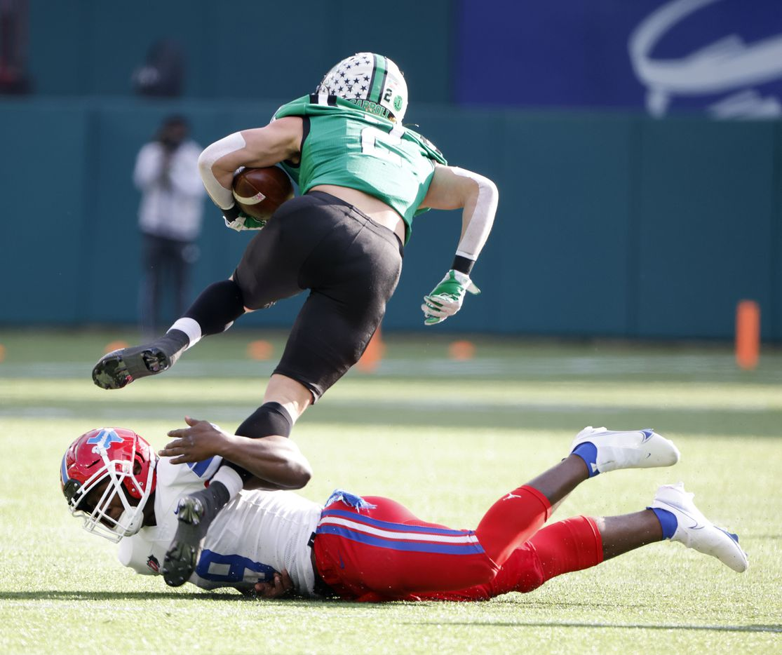 Duncanville's Kendrick Blackshire (9) tackles Southlake wide receiver Corban Duwe (5) during the Class 6A Division I state high school football semifinal in Arlington, Texas on Jan. 9, 2020. (Michael Ainsworth)