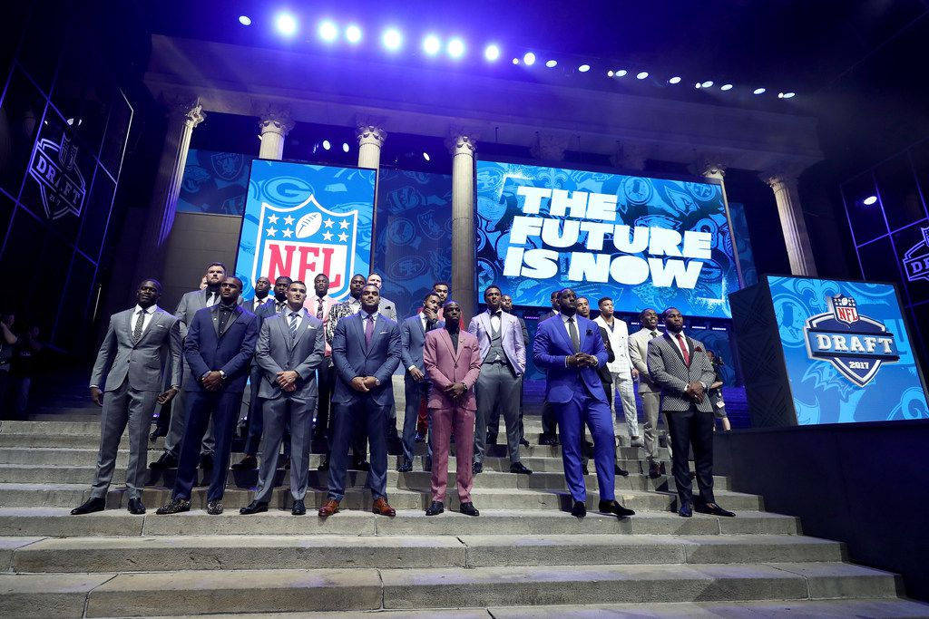 PHILADELPHIA, PA - APRIL 27:  The Top Draft prospects pose on stage prior to the first round of the 2017 NFL Draft at the Philadelphia Museum of Art on April 27, 2017 in Philadelphia, Pennsylvania.  (Photo by Elsa/Getty Images) ORG XMIT: 700030902