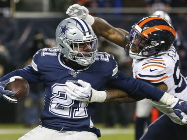 Chicago Bears outside linebacker Leonard Floyd (94) works to bring down Dallas Cowboys running back Ezekiel Elliott (21) during the second half a NFL matchup between the Dallas Cowboys and the Chicago Bears on Thursday, Dec. 5, 2019, at Soldier Field in Chicago.