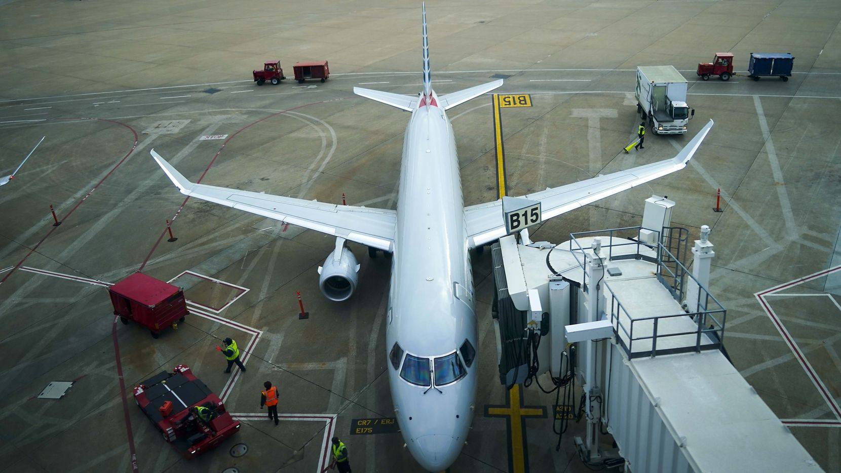 American Eagle planes parked at their gates at DFW International Airport.