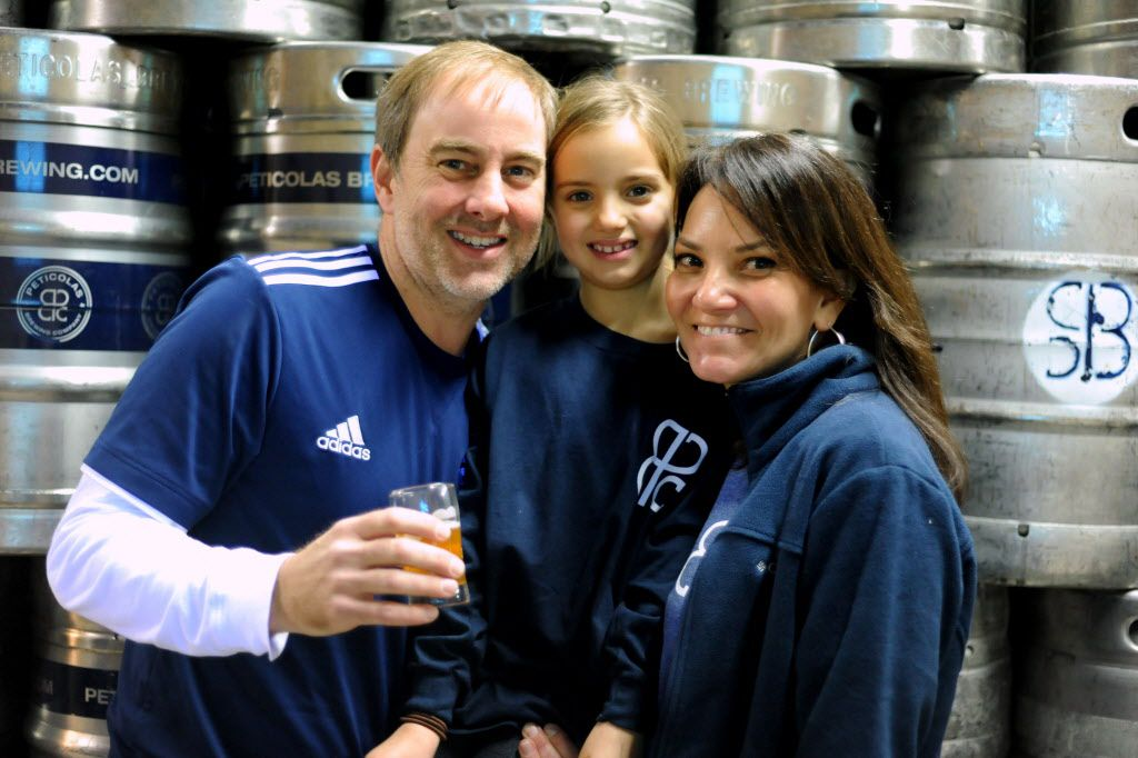 """Michael Peticolas, seen here with his daughter Lola, and wife, Melissa, said there's """"no rational basis for the law."""" (Alexandra Olivia/Special Contributor)"""